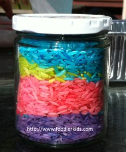 Jar filled with layers of dyed rice