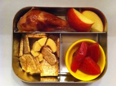Chicken, apple, cracker, cheese, and beets in a Lunchbots Trio