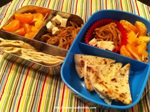 Two bentos with pita, noodles, tofu and fruit