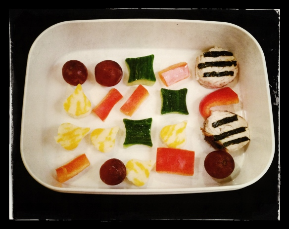 "Chicken circles and seaweed ""special candies"", red pepper, grapes, cheese"